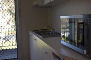 canberra short term holiday accommodation kitchen cooking facilities microwave stove cook bake kitchenette balcony equipped